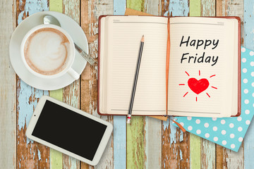 """Happy Friday""on notebook with smart phone and coffee cup"