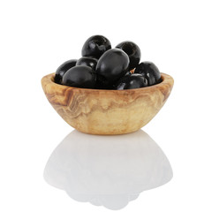 black olives from can in wood bowl