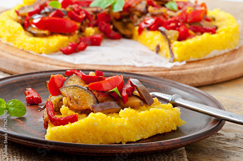 Polenta with vegetables - corn grits pizza with tomato and eggpl - 71624710