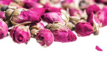 Closeup of dried rose buds on white background