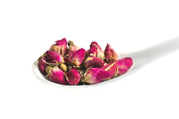 dried rose budson spoon  isolated on white background