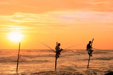 Silhouette of a stick fishermen at sunset, Unawatuna, Sri Lanka