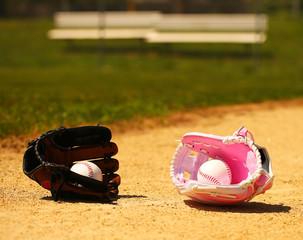 Baseball. Balls in Gloves on Green Grass. Female vs Male. Concep