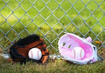 Baseball. Balls in Gloves on Green Grass. Female vs Male.