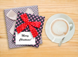 Merry Christmas note on gift box with coffee cup
