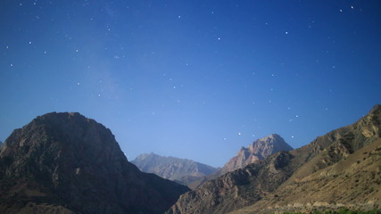 Stars over the mountains. Iskanderkul. Tajikistan. TimeLapse. 4K