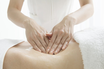 Slimming massage around the waist