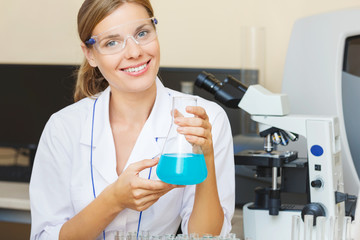 Young beautiful scientist working with samples in lab.