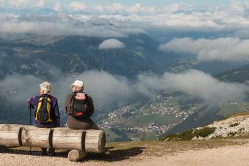 pensioners resting above Vale Gardena in Dolomites