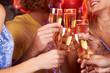 Obrazy na płótnie, fototapety, zdjęcia, fotoobrazy drukowane : Five hands raising champagne flutes in a toast