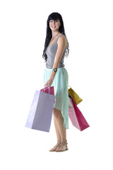 Young attractive girl carrying shopping bags isolated on white
