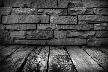 old Wooden floor with grunge stone wall in the dark with BW