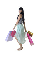 Young attractive girl walking shopping bags isolated on white