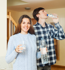 Smiling couple  drinking clean water
