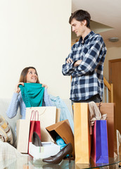 Woman showing purchases to boyfriend
