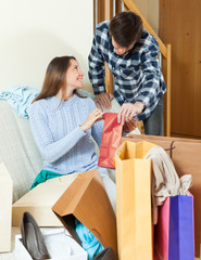 Smiling woman showing purchases