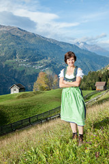 Woman in Dirndl in the mountains