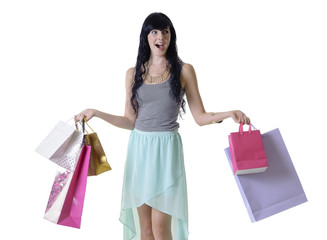 Young happy shopper girl with surpirsed facial expression