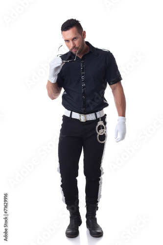 Trendy cop posing at camera, isolated on white - 71629916