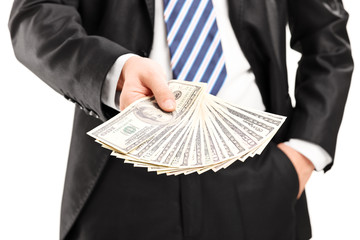 Close-up on a businessman holding money