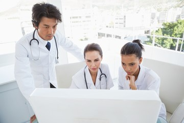 Hard working doctors reviewing notes
