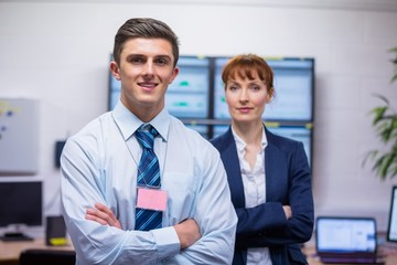 Smiling technicians standing at the camera with arms folded