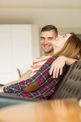 Cute couple relaxing on couch watching tv