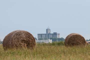 factory and two bales of hay