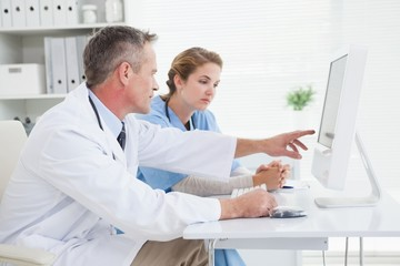 Doctor and nurse looking at a computer