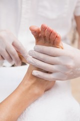 Salon worker with customers foot