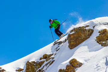 Skier jumping off a cliff