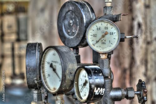 Leinwandbild Motiv Indicators for the measurement in an old factory.