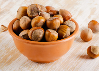 Hazelnuts on a  wooden background