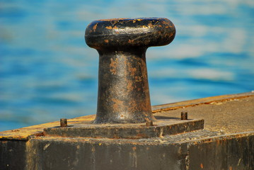 Rusty old bollard on the dock