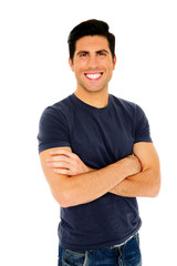 Portrait of a happy man with arms folded over white background