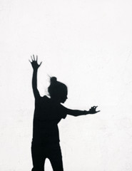 Girl jumping  around on the white wall background