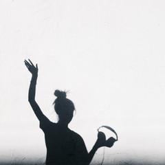 Photo of shadows of dj woman with headphones
