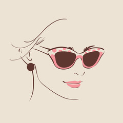 beautiful woman in glasses with earring