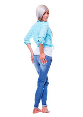 Young woman in a turquoise shirt with bare feet