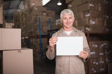 Warehouse worker holding blank board