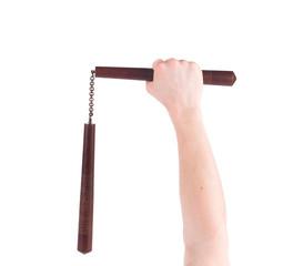 Hands hold martial arts nunchaku.