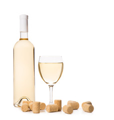 Glass of white wine with corks