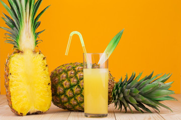 Half of Fresh ripe pineapple and juice