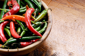 Bowl of green and red chillies