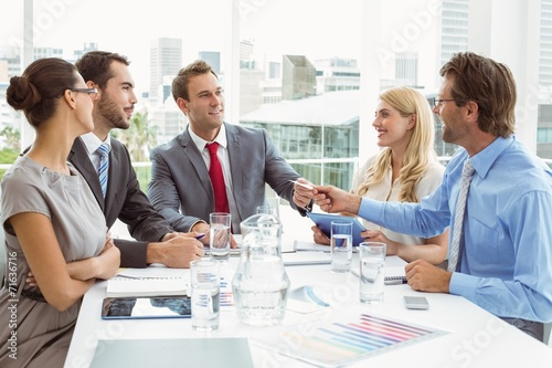 canvas print picture Young business people in board room meeting