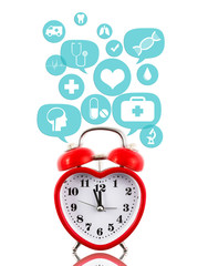 Heart alarm clock with medical icons in talk bubbles isolated