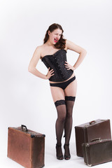 Young pin-up women with suitcase