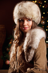 Closeup portrait of a beautiful woman at winter