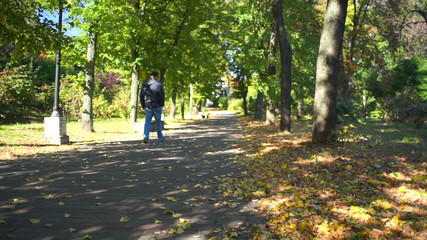 man walks in autumn park.