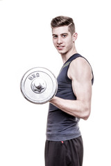 young man exercising lifting weight - isolated